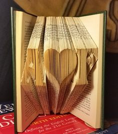 Custom hand made book fold sculpture, initials with heart. Perfect unique gift for any occasion!. A custom, made to order product, with the initials of your choice. Please search amazon store for other custom name/date books. Please note that FREE Economy shipping is Media Mail shipping with tracking provided.
