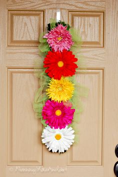 How to make a pretty, fresh and simple spring/summer wreath. I like that this one is a different kind of wreath, might work better on my door.  You can find this in the April archives inside ~
