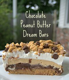 Chocolate Peanut Butter Dream Bars – crushed peanut butter sandwich cookies, topped with chocolate pudding, a fluffy layer of cream cheese and peanut butter, and finished off with Cool Whip.