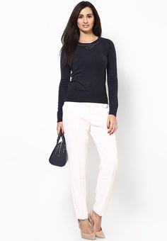 Now, maintain your fashionable status even during those chilly days wearing this blue coloured jumper from Dorothy Perkins. Fashioned from 100% acrylic, this jumper is designed to provide you ultimate comfort all day long. Featuring neat embellishment around the neckline, this jumper will look best when teamed with beige pants and belly shoes.
