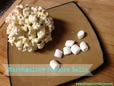 Marshmallow Popcorn Balls --but add white chocolate drizzled on them!