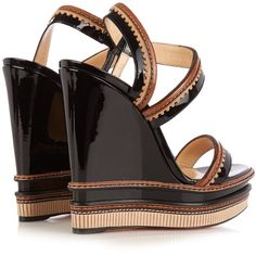 Christian Louboutin Trepi 140mm patent-leather wedge sandals ($593) ❤ liked on Polyvore featuring shoes, sandals, strap shoes, patent leather wedge sandals, strappy wedge sandals, bohemian sandals and patent sandals