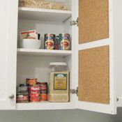 Cork board inside cabinet. A large door like pantry would be good space for bills and school newsletters etc.
