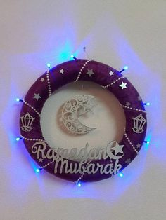 This purple and silvery mesh wreath with the islamic laser cut wooden sign and LED lights is a perfect decoration for the muslim home for the holy month of Ramadan. This wreath can be also made with Eid mubarak wooden sign. If you want different colors for the mesh or the wooden sign