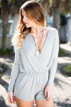 """Always There Grey Ribbed Long Sleeve RomperEvery girl has that one item in her closet that is her go to no matter the occasion. Make this, """"Always There"""" grey ribbed romper your new favorite go to!Measurements are taken from underarmt..."""