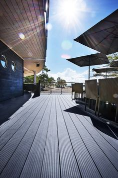 Beautiful and durable decking for restaurants. UPM ProFi Deck 150 Stone Grey in Yyteri, Pori, Finland. Wpc Decking, Midnight Sun, Grey Stone, Finland, Restaurants, Hotels, Colours, Building, Travel