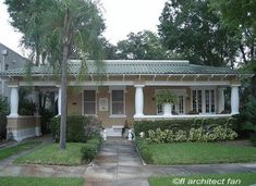 bungalow style home with a tiled roof