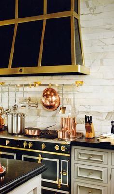 Black enamel, white marble, copper and gold accents