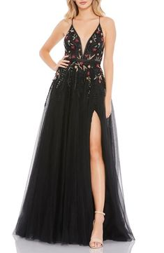 Planning a Halloween wedding? Or just love the edgy look of a black wedding dress? We've rounded up 32 of our favorite black wedding dresses that will totally make a statement on your wedding day. Say hello to the prettiest black wedding gowns you've ever seen. Pageant Gowns, Prom Dresses, Formal Dresses, Black Mac, A Line Gown, Tulle Gown, Lace Dress, Mac Duggal, Couture Fashion