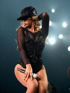 """Entertainer Beyonce performs on stage during """"The Mrs. Carter Show World Tour"""" at the Barclays Center on December 22, 2013 in New York, New York."""