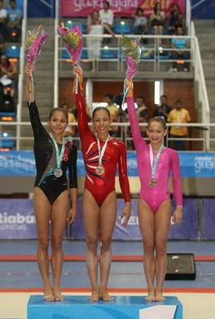 The balance beam medalists. Sabrina Vega won gold, Sarah Finnegan won bronze. Sarah is the cutest kid ever