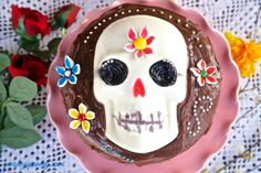 The picture is of a gelatin cake with a skull on top of it is a common food found throughtout places during Day of the Dead celebrations.  The websites show other foods and drinks commonly found during Day of the Dead.