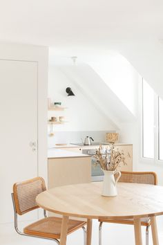 Small Kitchen Remodeling small dining space // white and light wood dining room - Wanting to create a kitchen as economically as possible, two Paris architects added DIY plywood fronts to readymade cabinets—to great streamlined effect. Parisian Kitchen, Rustic Kitchen, Mini Kitchen, Cosy Kitchen, Kitchen Dining, Kitchen Decor, Cheap Home Decor, Diy Home Decor, Room Decor