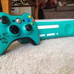 Sarah would love the color of this Xbox! and it looks really cool.