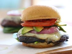 The Best Grilled Portobello Mushroom Burgers - marinated mushrooms that are grilled w/ melted Swiss Cheese then topped with grilled red onion, tomatoes, spinach, and avocado – yum!!