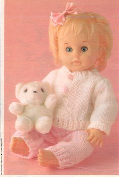 Pattern for Henley type top and pants (unnamed pattern) from Woman's Value, March Knitting Dolls Clothes, Baby Doll Clothes, Knitted Dolls, Baby Dolls, Knitting Ideas, Baby Knitting, Knitting Patterns, Doll Dress Patterns, Clothing Patterns
