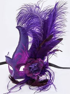 """Purple Mardi Gras Masquerade Mask with feathers and black silk ribbon ties. 6"""" wide, 8.5"""" tall mask, 12"""" tall mask with feathers."""