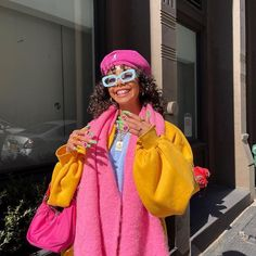 Chic color blocked outfit with bright pink, orange, and baby blue. Puffy sleeves, beret hat, funky glasses, pink bag, blue accessories. Visit Daily Dress Me at dailydressme.com for more inspiration women's fashion and trends. Pop of color, vibrant colors, funky outfit, New York street style, blue accessories, accessories, glasses, hat, scarf, jacket, pink and orange, spring outfits. Colourful Outfits, Colorful Fashion, Cool Outfits, Casual Outfits, Fashion Outfits, Womens Fashion, Aesthetic Fashion, Aesthetic Clothes, Daily Dress Me