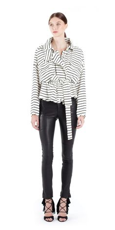 Seeing stripes in this graphic version of our classicKayla silhouette. - Oversized collar - Center front zipper and snap closure - Tie waist belt detail - Elas