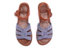 Enjoy sunny days in our charming Zoe Sandal. The Zoe features a cushioned insole guaranteed to make you smile.