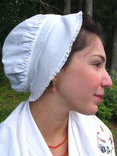 """Dormeuse (c. 1770-90) ~~ The most stylish day cap of its period, this one is edged with a ruffle of delicate 3/8 inch cotton lace. Not too upscale for a camp-follower, nor too plain for dressier occasions, this is a truly all-purpose RevWar period cap! You can see it on a working class young woman in Henry Walton's 1776 painting, """"Plucking the Turkey"""""""