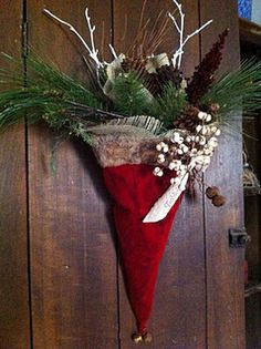 Do you think a festive Santa hat filled with evergreens and the like would beat out a traditional wreath on the door to win the http://Texas Christmas House.com competition?
