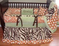 Kinsley Baby Bedding  Included in this set is the bumper, soft minky backed blanket, and full ruffled crib skirt (can be made tailored too).  There is lots of detail in this custom set including soft sage minky, chocolate grosgrain ties, orange/cream dots and damask, and zebra cotton too.