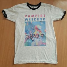 Vampire Weekend Ringer T-Shirt Adorable and unique Vampire Weekend t-shirt! I'm not sure where I got this from, but I haven't been able to find another VW shirt like this! Worn once or twice. It's a bit big so I believe it's a men's medium and not a women's. Not Hot Topic, just tagged for exposure! Hot Topic Tops Tees - Short Sleeve