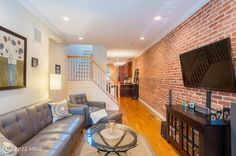staircase configuration / wall-mounted tv on brick    837 KENWOOD Ave SOUTH, BALTIMORE, MD 21224 | MLS# BA7894406