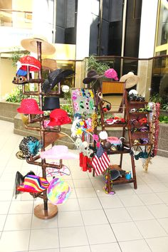 Our prop stand and hat rack with the rustic western saloon photo booth at St Joseph Medical Center's Nurses week party. http://thelookingglassphotobooths.com/index.html