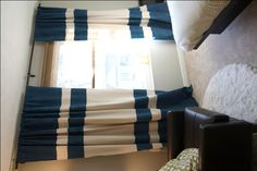 curtains sewn out of canvas dropcloths with stripes painted on. love these (don't know why the pic is sideways, it isn't on the website).