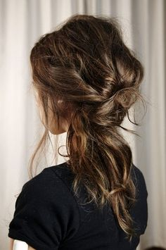 Here's another version of textured hair in a low ponytail but this one is tied and bit more messy (which we like!)