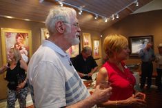Solberg enjoys the reception with SKB artist and instructor Christine Knapp.