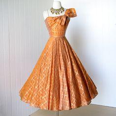 vintage 1950's dress ...stunning FRANK STARR ORIGINAL pumpkin spice organza w/gold asymmetrical bodice full circle skirt party dress. $330.00, via Etsy.