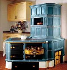 Image may contain: indoor Vintage Appliances, Kitchen Appliances, Chalet Interior, Interior Design, Küchen Design, House Design, Home Furnace, Wood Burning Cook Stove, Build Your House