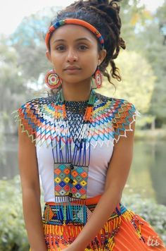 For Iron to make noise, there must be two pieces of it.  Zulu Proverb  Model: I-Kaya  Designer: Intombi Beads.