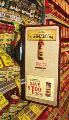 Signs with coupons, cut-to-shape signs and bold colors and fonts make these products stand-out on the grocery store aisle.