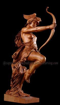 Archer, carved wood sculpture, basswood -- Fred Zavadil