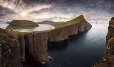The largest lake in the Faroe islands just 30m above the sea level | by Janne Kahila. [1500895] xpost /r/SeaPorn. #reddit
