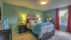 Girls bedroom featured in The Wellington @ Canterbury Farms. Model home interior design by ShopGirl for Goodall Homes.