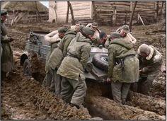 Stuck in the deep mud, German soldiers struggle to move a Type 82 Kubelwagen of the 1st SS Aufklärungs-Abteilung LSSAHSS Division in the Vinnytsia region of the Ukraine. November 1943