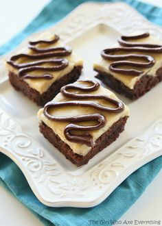 These Salted Caramel Coconut Brownies are moist, chewy coconut brownies with a salted caramel glaze and chocolate drizzle. Recipe courtesy of @GirlWhoAte