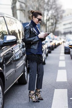 Layers with striped pants and ahmazing heels.