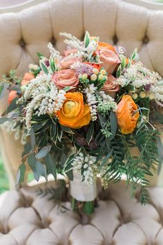 Orange and ivory flowers make a lovely fall wedding bouquet. | Pretty Vintage Rentals - California weddings