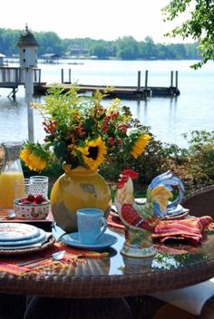 French country table scape, love the rooster and the yellow pottery from Pottery Barn...