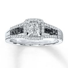 this sophisticated vintage white gold three row black and white diamond engagement ring sports a round prong set diamond center the shank featu - Black And White Diamond Wedding Rings