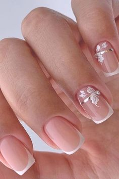 nail ideas wedding french bridal nails with white flowers and silver rhinestones lyasha_nevskaya Are you dreaming about the perfect bridal look? Don't forget to choose cool design for your nails. You will find in our gallery cute wedding nail ideas. Bride Nails, Wedding Nails For Bride, Wedding Nails Design, Nail Wedding, Bridal Nails Designs, Nail Tip Designs, Wedding Manicure, French Nail Designs, Cool Designs