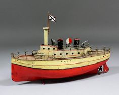 An early 20th Century German tinplate clockwork two funnel gunboat by Carette, circa 1905-1910, 13ins long (some repainting)