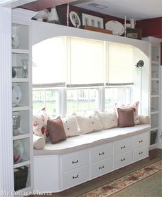 This DIY window seat alcove started its life as an old set of drawers from a turn-of-the-century house that was being demolished. Using cost-saving salvaged building materials as the core, blogger Melissa Thorn at MyCottageCharm.com added side cabinets, a valance, and crown moulding to complete this light-filled getaway.