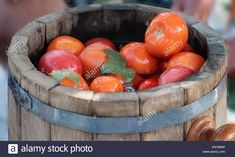 Download this stock image: In large oak barrels delicious pickled tomatoes with spices: dill, currant leaf, cumin. - KN7M6W from Alamy's library of millions of high resolution stock photos, illustrations and vectors.